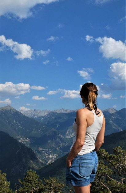 Cheryle looking out over a mountain range