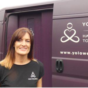 Cheryle standing in front of the YOLO Wellbeing van